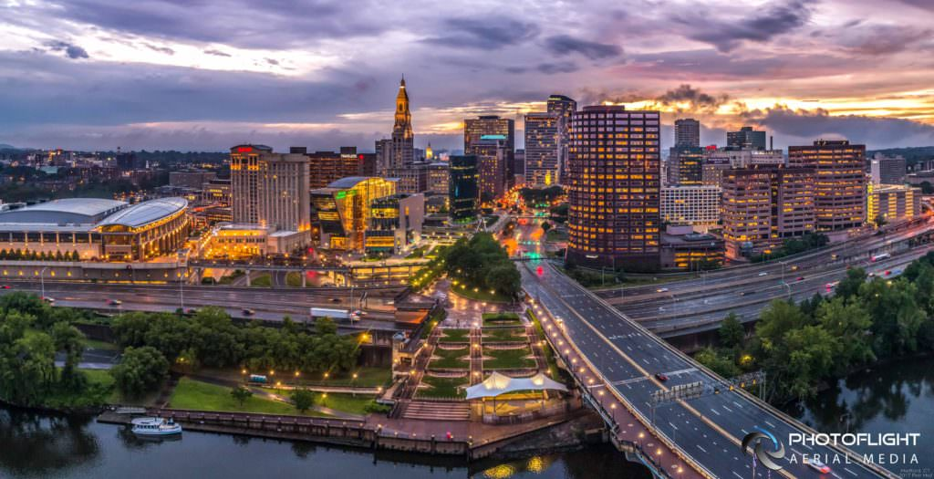 Hartford Riverside and Downtown Twilight Drone Photograph by PhotoFlight Aerial Media - Media Asset Ref PAN2017-022