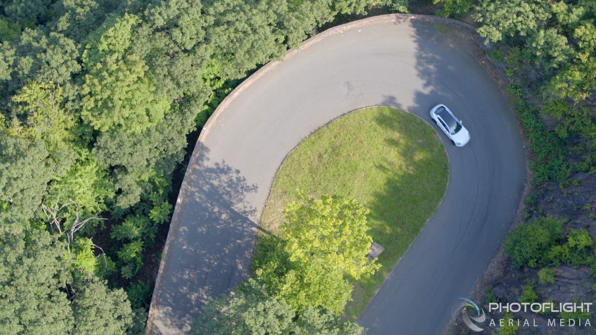 top down drone photo of car by photoflight aerial media
